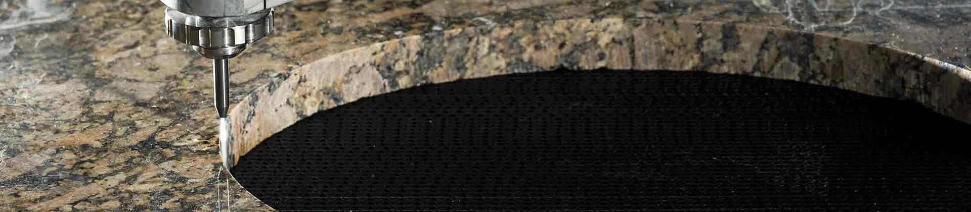 Рязане на камък и плочки с водна струя